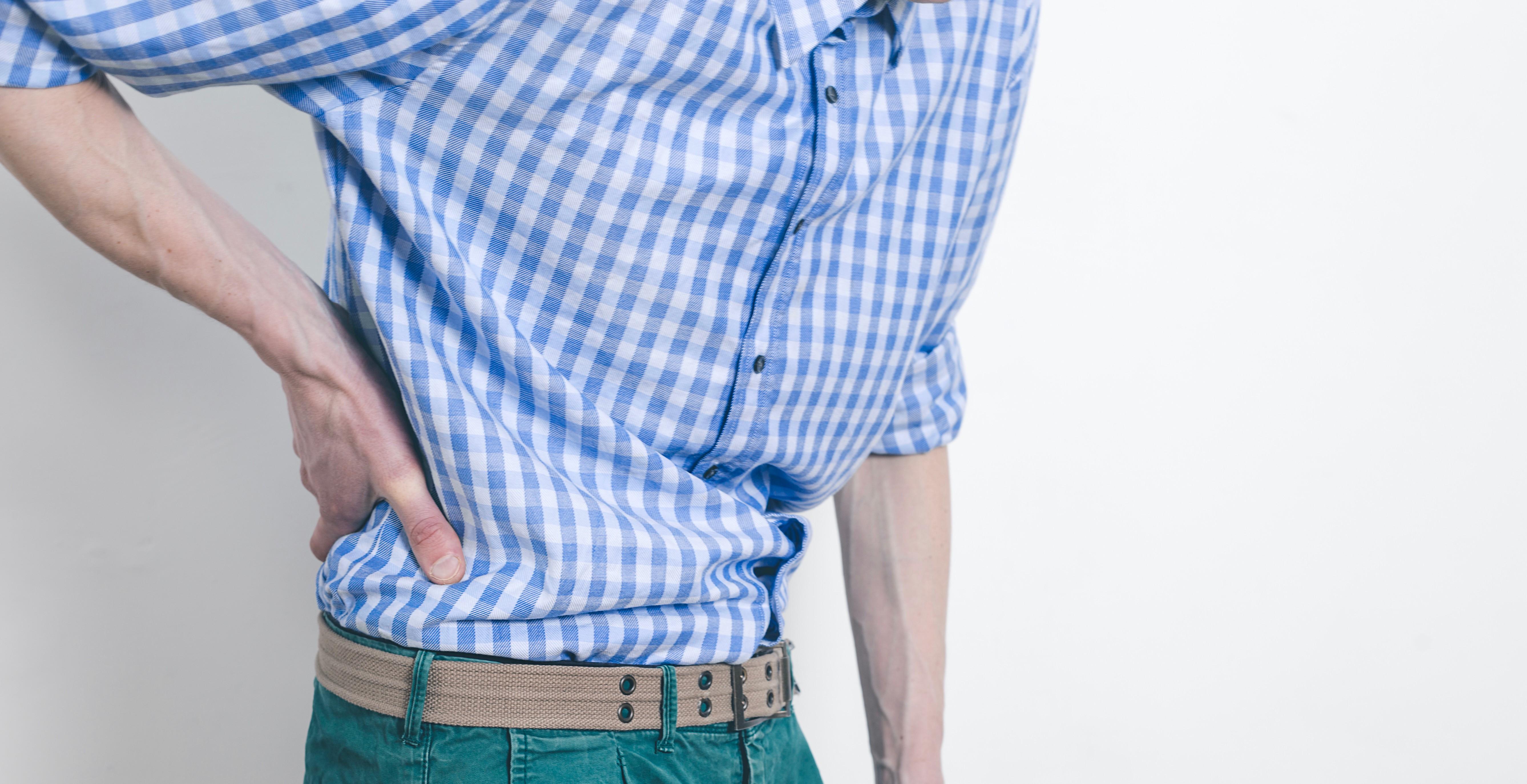 pain-kidneys-man-holds-sore-back